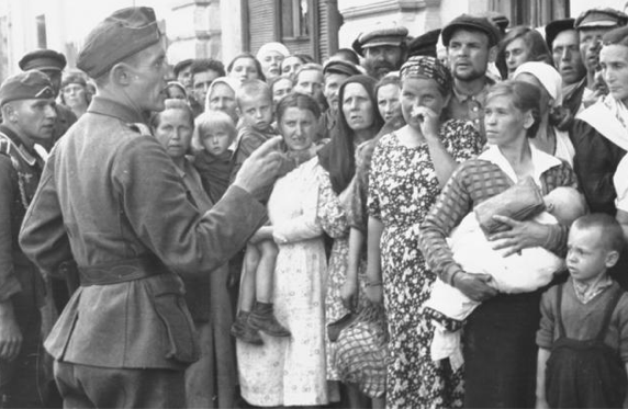The German forces arriving in Mogilev tell the Jewish women that they have to 'register' with the authorities. On the 26th July 1941 the Germans captured
