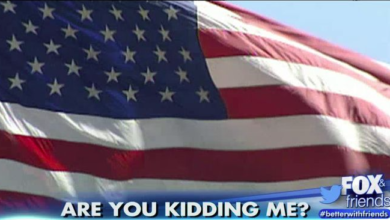 Photo of American Flag Displays Denied—Threat to Muslims and Foreigners