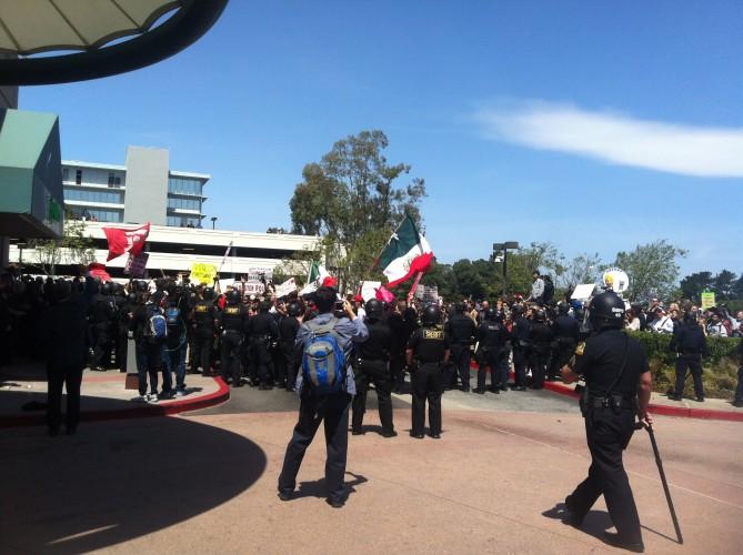 Anti-Trump rioters outside CA GOP Convention ring the Hyatt Regency