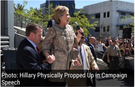 On Clinton's right, the telltale thumb-in-fist-grab showing Clinton is putting most of her weight onto her right, the man also supporting her underneath her arm. On her left, that man has his right hand extended with his open hand thumb up in case Clinton should falter, he is ready for her to grab it. Behind her is a blonde woman, quite likely one hand supporting the small of the back, the woman's hand there underneath Clinton's left elbow again, in case she should falter.