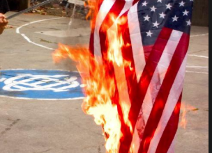 Photo of Burning a Flag – Act of Policy Protest or Sedition?